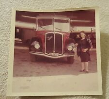 Vintage Photograph of Woman Standing by Old Antique Car picture