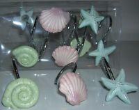 Brand New 12 sea shell/Fish stars shower curtain hooks in Box by creative bath