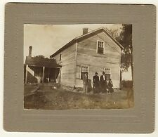 PHOTO OF AN AFRICAN AMERICAN FAMILY IN FRONT OF THEIR HOME IN TEXAS HILL COUNTRY
