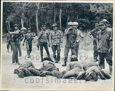 1970 Cambodia Soldiers Crawl on Road as Punishment For Stealing  Press Photo