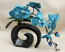 ARTIFICIAL SILK MOTH ORCHID IN TEAL WITH LEAVES IN BLACK FOSSIL VASE