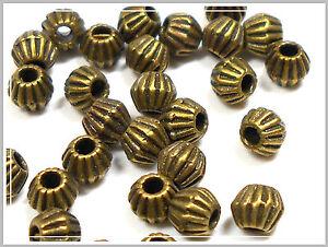 25 kleine Metallperlen bronze bicone 4.5*4mm