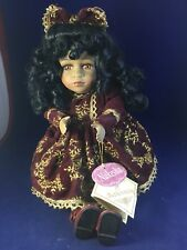 Collectors Choice Musical Animated Wind Up Porcelain Doll - name is Nakesha