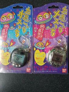 Rare Original Bandai 1997 Osutchi/Mesutchi Tamagotchi - black and clear