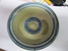 Blue and beige stoneware candlestick holder with markings