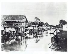 1942 Vintage Photo boats on river near Malayan Homes in Pontianak Indonesia WW2