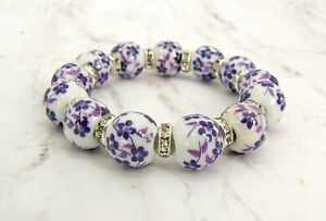 Purple flower porcelain beaded stretch bracelet with crystal spacer beads  - NEW