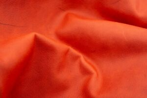 Semi veg tan leather sheets in dark salmon pink color with rustic look