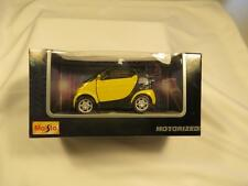 Maisto Smart Car Motorized 1:33 Scale Pull Back