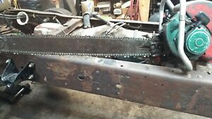 1960 homelite 700g, 92.5 CC gear drive chainsaw with 34-in roller nose bar
