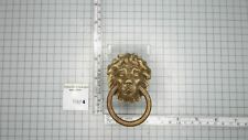 BRASS LIONS HEAD ORNAMENT FOR A FRENCH MANTEL CLOCK