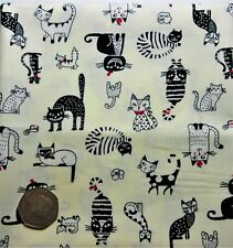 fat quarter of cotton poplin with fun cats in black, white, red on ivory