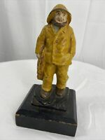 Antique/Vintage Cast Iron Old salty fisherman w/Yellow Rain Coat 6.25""