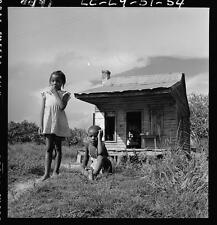 African American girl,boy,dilapidated cabin,poverty,living conditions,South,1951