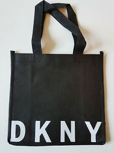 DKNY Carrier Bag Small. Black with logo, canvas style fabric.