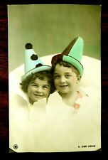 SWEET CHILDREN PIERROTS BREAKING THROUGH PAPER Hand Colored Photo Postcard c1907
