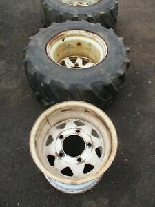 2 x used 31 x 15.50 - 15 flotation tyres with rims