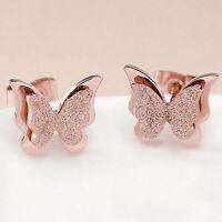 Aretes de mariposa de acero inoxidable de titanio con oro rosa de 18 quilates