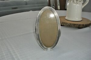 ANTIQUE OVAL TABLE TOP PICTURE FRAME, BALL FEET, EASEL STAND, POSSIBLY SILVER 6""