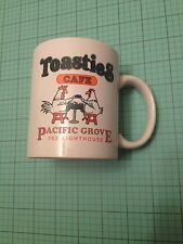 Toasties Cafe Pacific Grove white coffee cup with rooster and chicken logo