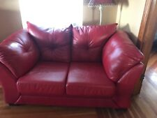 red leather love seat, lightly used, from Jordan's furniture, great condition
