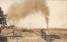 WYMORE, NE ~ TRAIN LEAVING DEPOT STATION ~ MARTZ REAL PHOTO PC ~ c. 1907-1915