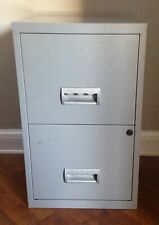 Grey two drawer metal filing drawer. width 15.5 height 26 depth 15.5 inches