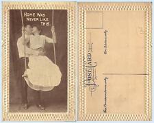 Loving Couple Kissing on Swing c1909 Romance Love People Postcard