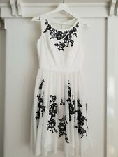 White size 8 Review dress. Chiffon with black embroidery.  Excellent condition