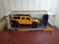 Jada Just Trucks 2011 Ford F-150 SVT Raptor Pickup 1:24 Diecast Tire Rack Yellow