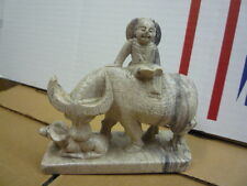 vintage carved ox and baby ox and a man riding on top figure statue figurine