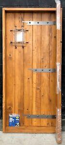 Rustic reclaimed lumber square top door solid wood wine cellar castle iron cage