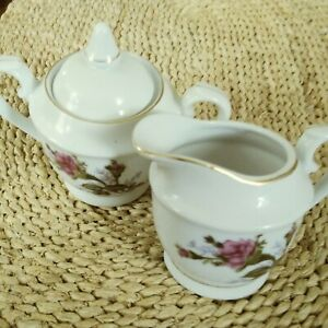 """VINTAGE WHITE CHINA CREAM & SUGAR WITH A FLORAL DESIGN & GOLD TRIM, 3"""" & 4"""" TALL"""