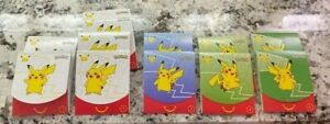 LOT OF 12 UNOPENED POKEMON PACKS FROM McDONALDS HAPPY MEAL TOY 25th ANNIVERSARY