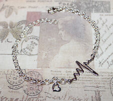 Quirky heartbeat and heart silver plate charm bracelet
