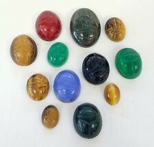 * LOT OF 42.9 CARATS OF ASSORTED OVAL SCARAB CABOCHON LOOSE GEMSTONES CARVED