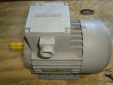 New Seimens 1LA2063-2AA10 1/3 HP 230/400 Volt Motor with face mount adapter.