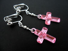 A PAIR OF DANGLY  PINK ACRYLIC CROSS GIRLS  CLIP ON EARRINGS. NEW.
