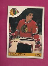 1985-86 OPC # 86 HAWKS ED OLCZYK ROOKIE CREASED CARD (INV# A1400)
