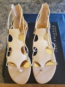 Very Volatile beige patent sandals, split toe, gladiator style, size 9
