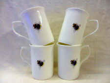 Set of 4 bone china mugs in bumble bee design.