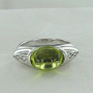 A GOOD CABOCHON PERIDOT AND DIAMOND, 18 CARAT WHITE GOLD RING..