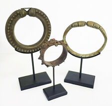 Three Antique Ethnographic Bracelets on Museum Display Stands