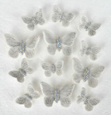 12 Edible butterfly cake decorations in white and silver. Wedding cake toppers