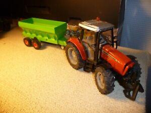 tracteur massey ferguson  5455 siku avec une remorque