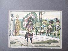 Antique Christmas Card Little Girl With Parasol Promenading Boys on Bench Chromo