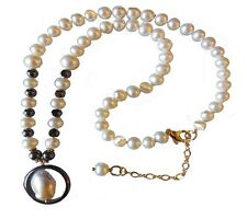 NEW:Hematite circle around baroque pearl pendant on hematite and pearl necklace.