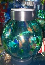 Solar blown glass lantern with clear string lights. Turquoise