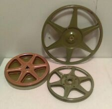 Three Metal Reels, One With Holding Tin