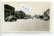 Pomeroy WA (Garfield Co) RPPC real photo Main Street view, signs, old cars